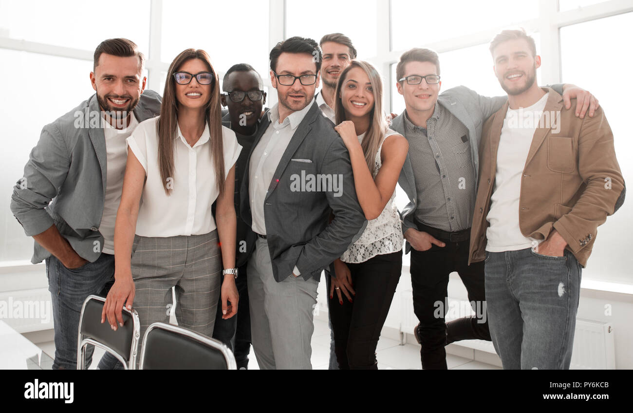 ambitious business team standing in a modern office Stock Photo