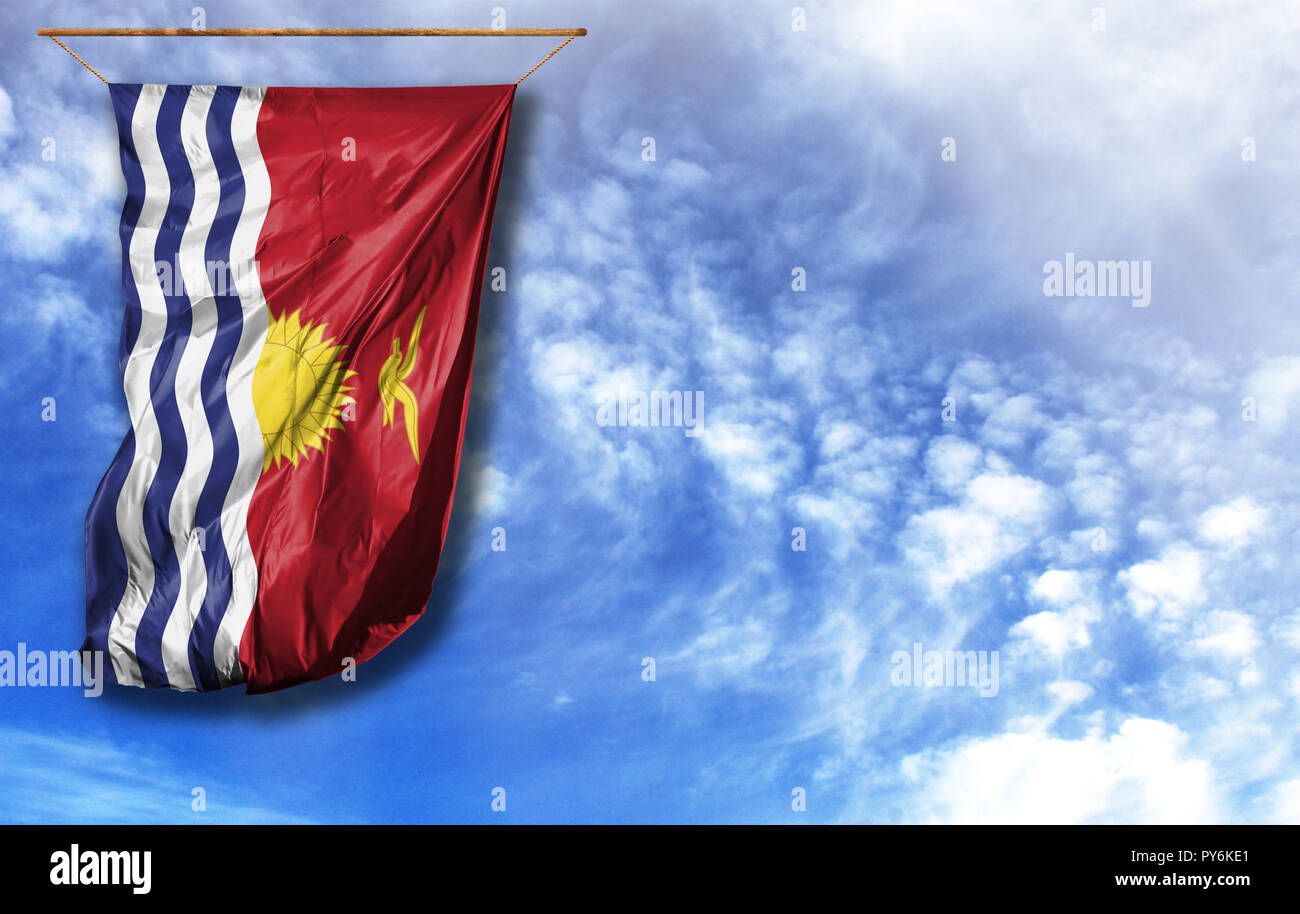 Flag of Kiribati. Vertical flag, against blue sky with place for your text - Stock Image