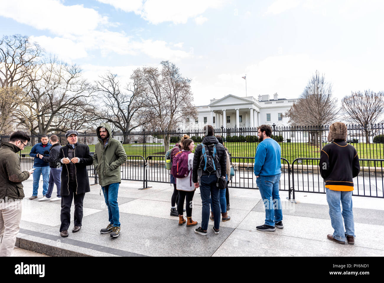 Washington DC, USA - March 9, 2018: Crowd of many people at White House President building in capital city of United States in cold winter, standing o Stock Photo