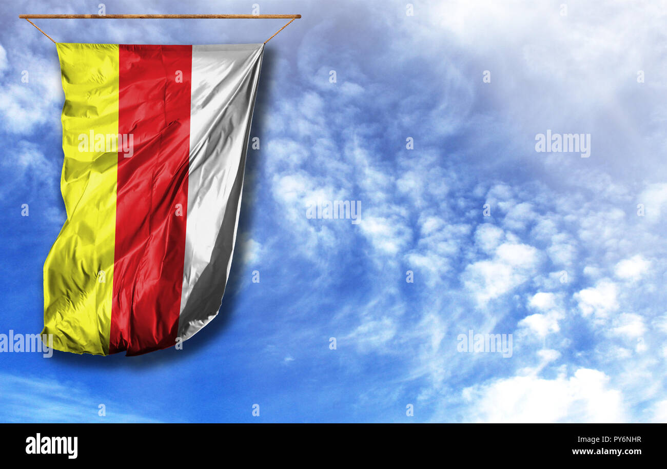 Flag of South Ossetia. Vertical flag, against blue sky with place for your text - Stock Image