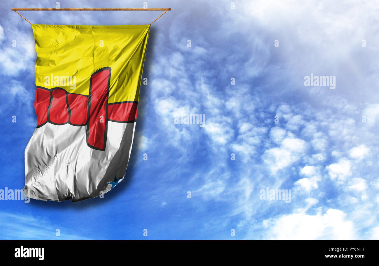 Flag of Nunavut. Vertical flag, against blue sky with place for your text - Stock Image