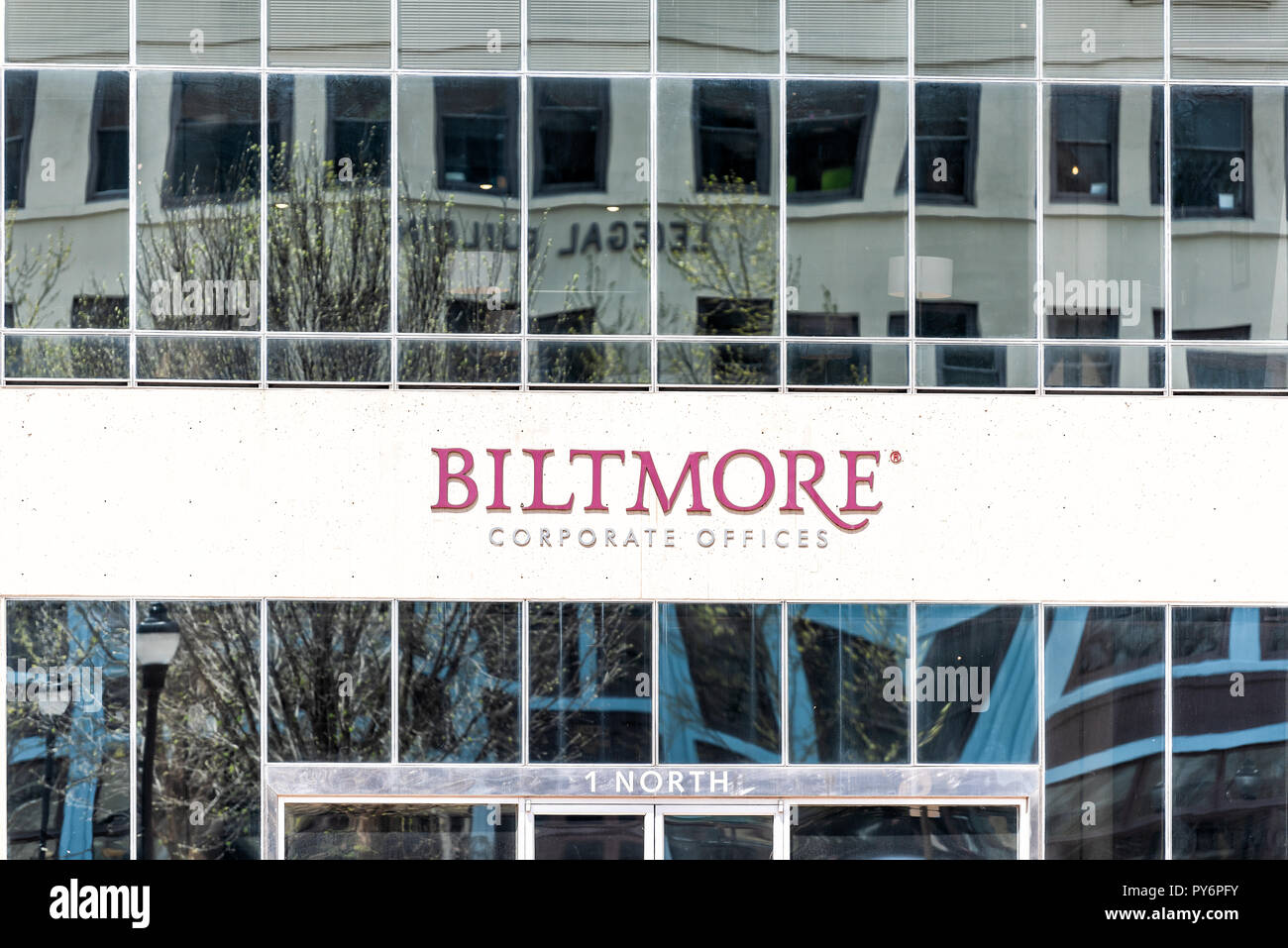Asheville, USA - April 19, 2018: Downtown old town hipster North Carolina NC famous town, city with closeup sign for Biltmore corporate offices - Stock Image