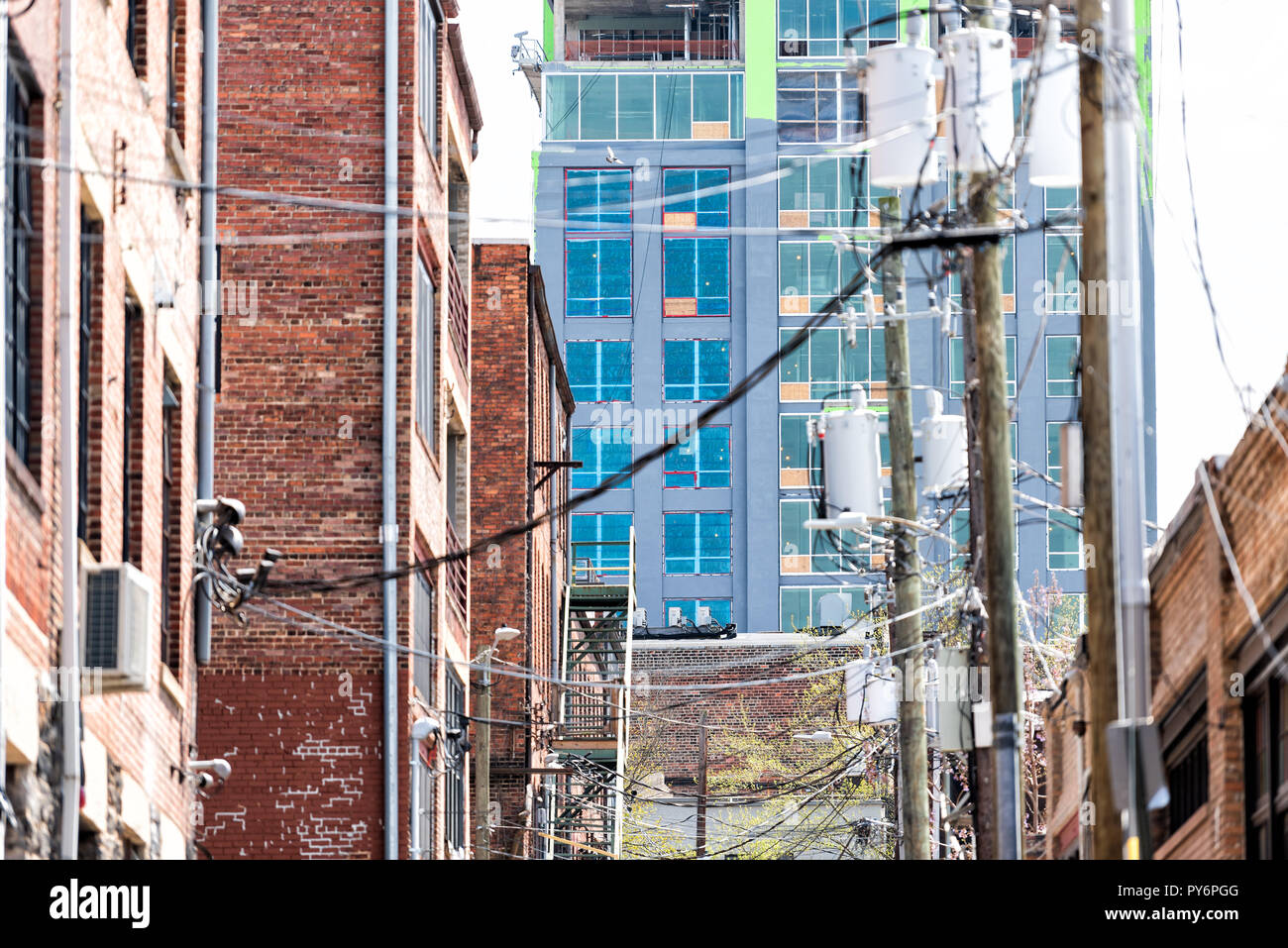 Asheville, USA Downtown old town street in hipster North Carolina NC famous town, city, nobody, many wires overhead cables, construction - Stock Image