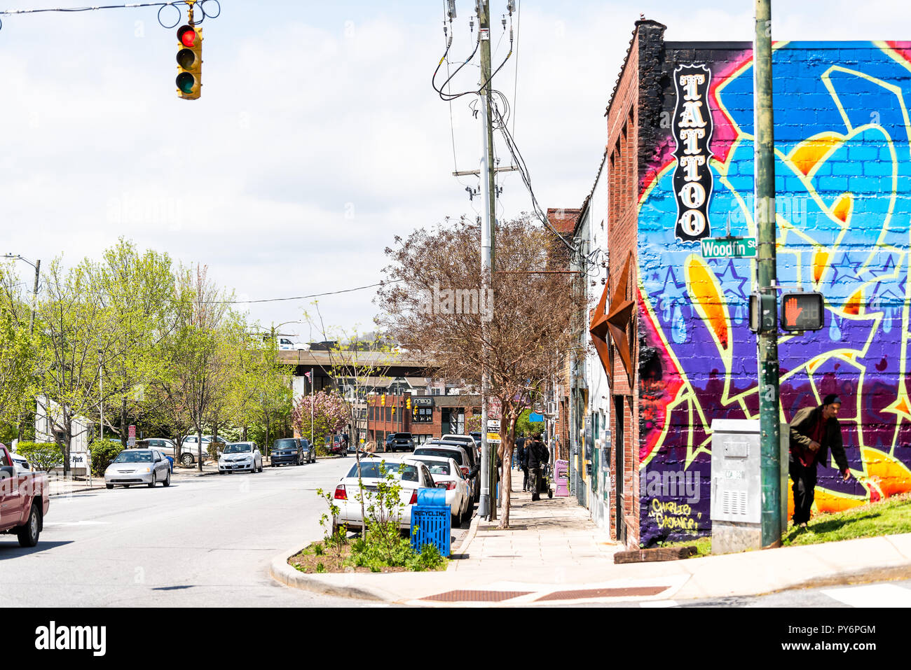 Asheville, USA - April 19, 2018: Colorful Tattoo tattooing and piercing store, shop, in downtown on Woodfin Street - Stock Image
