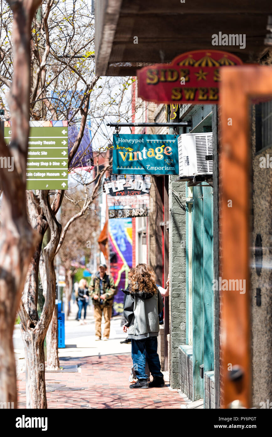 Asheville, USA - April 19, 2018: Downtown old town street in North Carolina NC city with stores, shops, sign for vintage emporium - Stock Image