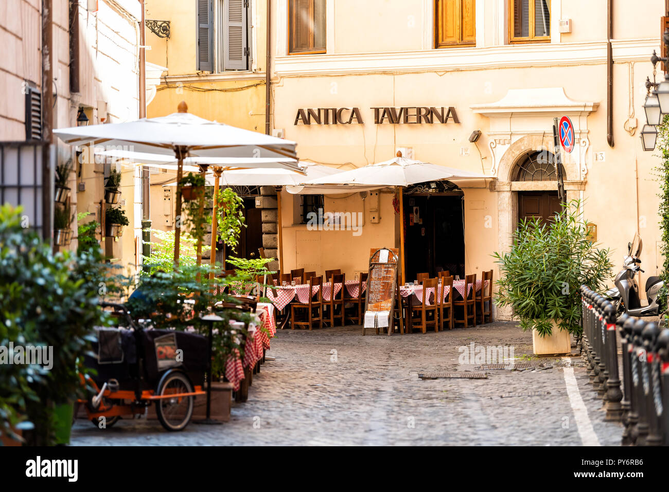 Rome, Italy - September 4, 2018: Italian restaurant tables, chairs, outside in traditional style, nobody on street cafe in historic city in morning, A Stock Photo