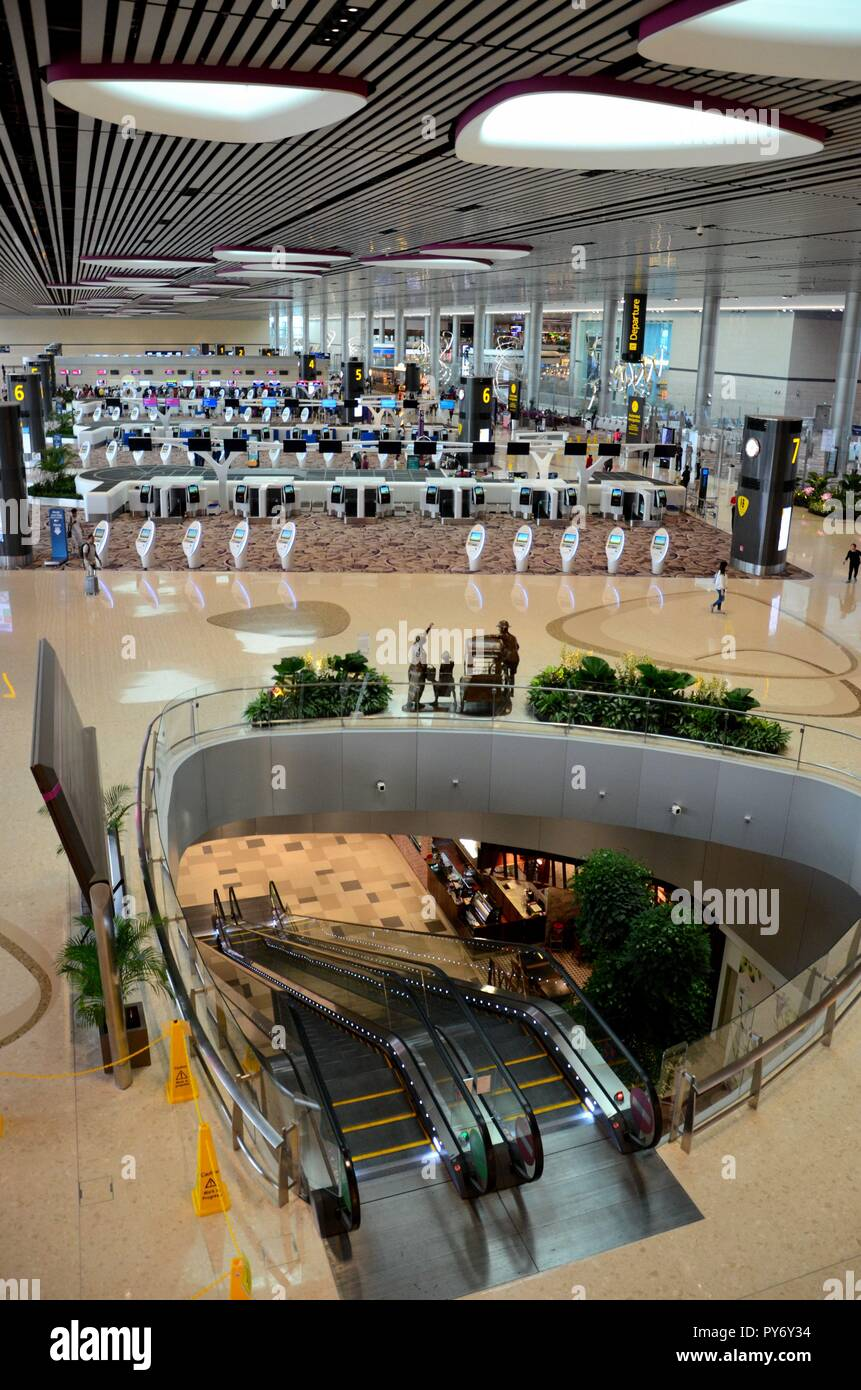 Check in counters and electronic kiosks departure lounge Changi airport Singapore - Stock Image