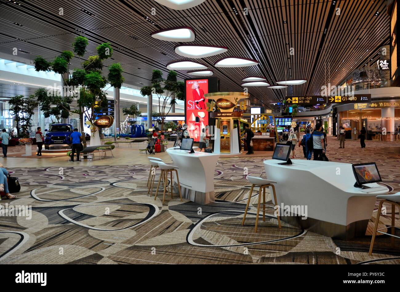 Travellers inside immigration area near departure gates at Changi T4 Singapore - Stock Image