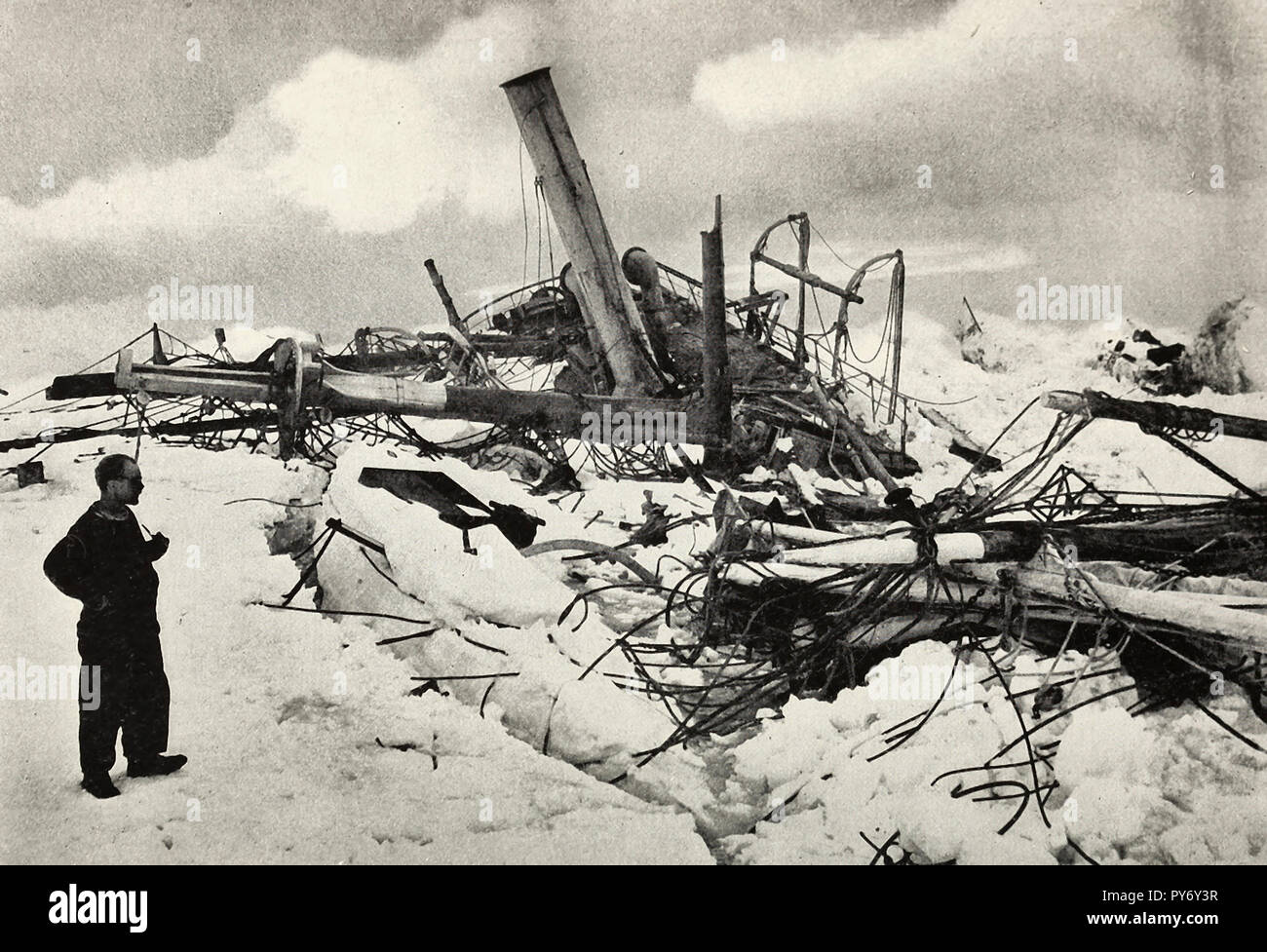 The ship was dead. Her proud timbers were rent apart and scattered in savage confusion. The wreck of the Endurance during the Shackleton Expedition - Stock Image