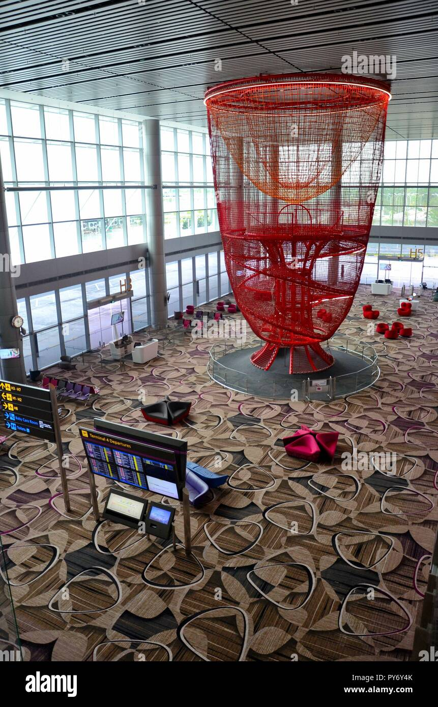 Large hanging art installation at departure gate Singapore Changi airport - Stock Image