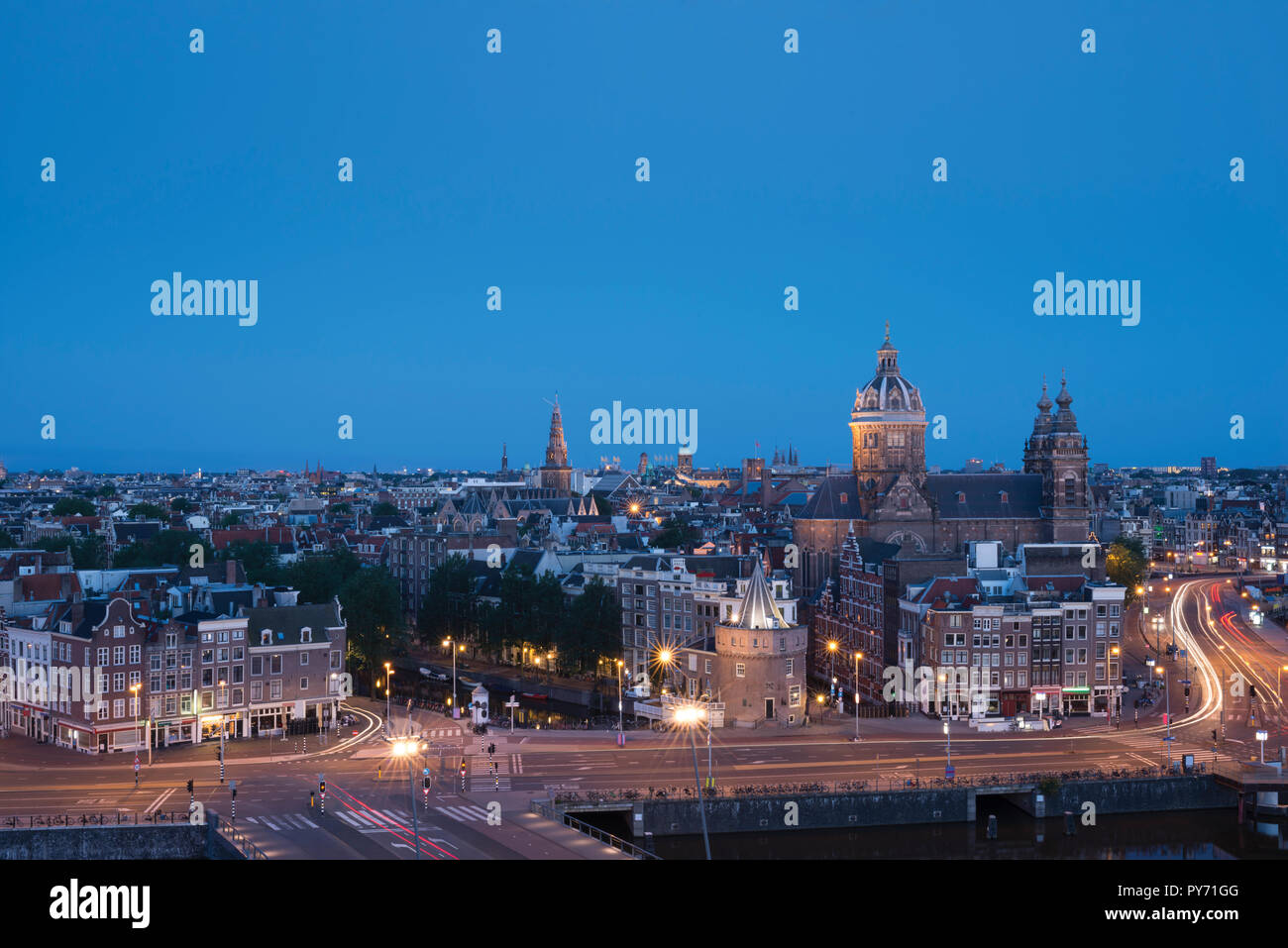 Early morning in Amsterdam, Netherlands, skyline with basilica Saint Nicholas (Nicolaaskerk) Stock Photo