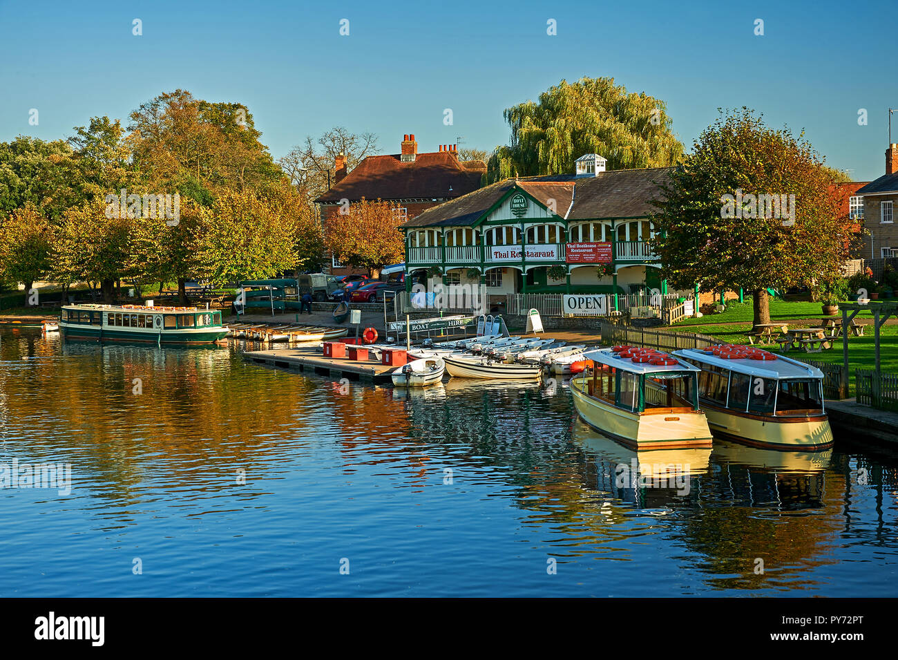 Stratford upon Avon and the old boat house on the River Avon on an autumn afternoon, with pleasure boats  moored at the end of the season - Stock Image