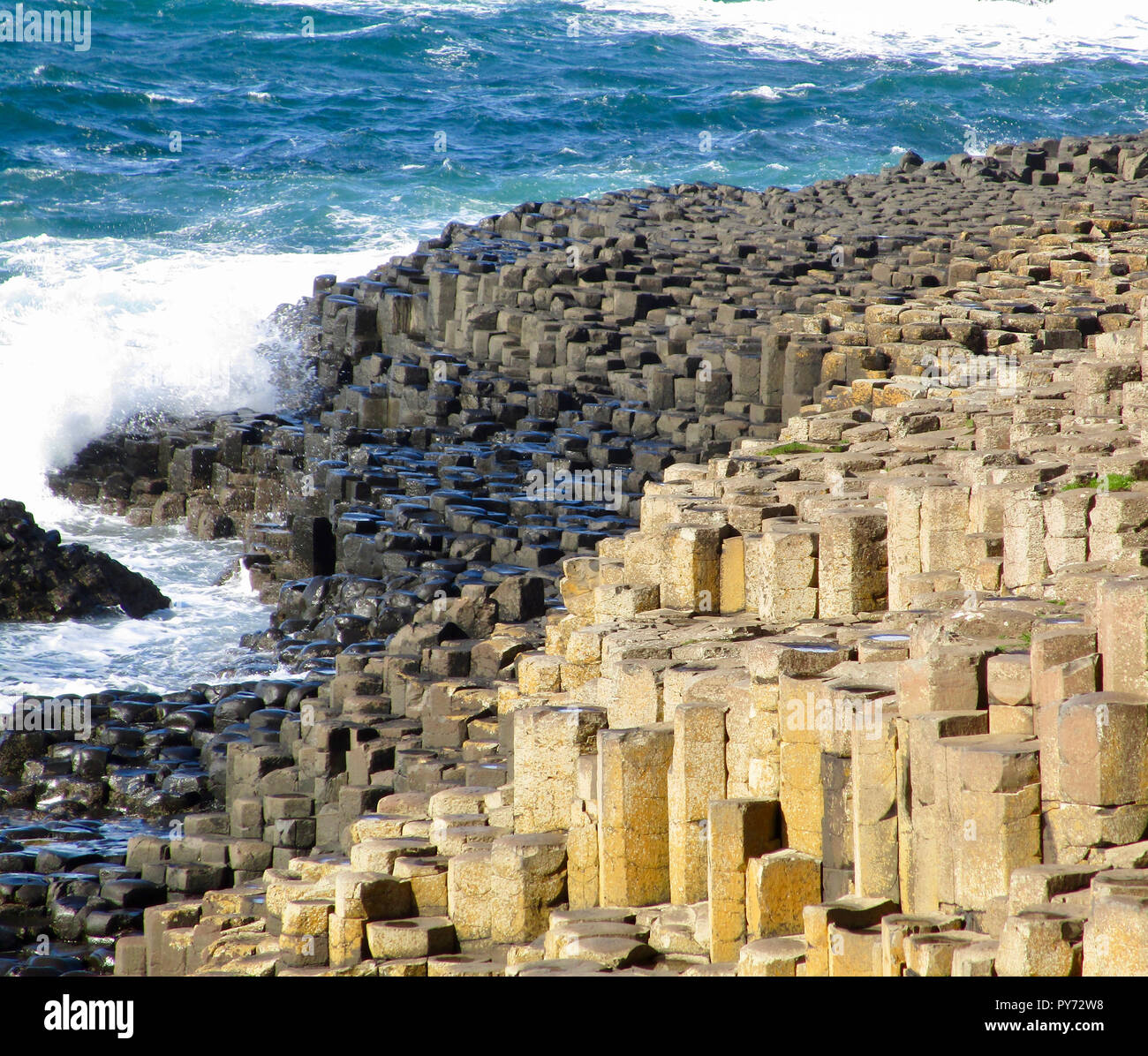 View of the hexagon shaped basalt stone columns in the landscape of Giant's Causeway in Northern Ireland Stock Photo