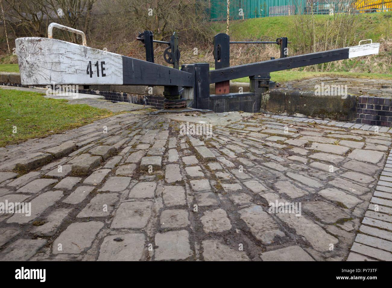 Lock gates on the Huddersfield Narrow Canal near Marsden in West Yorkshire - Stock Image