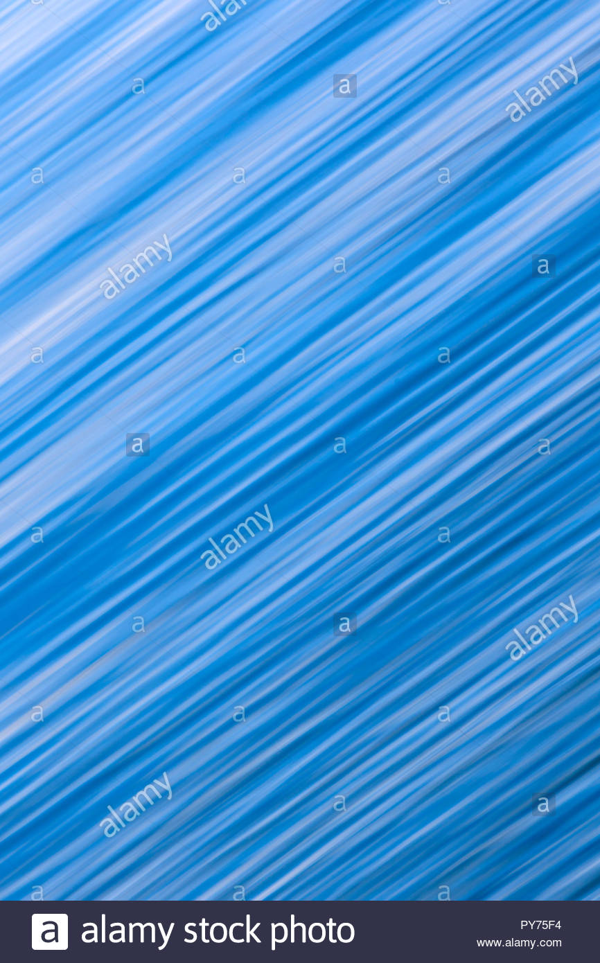 Abstract blue wave patterns streak from side to side Stock Photo