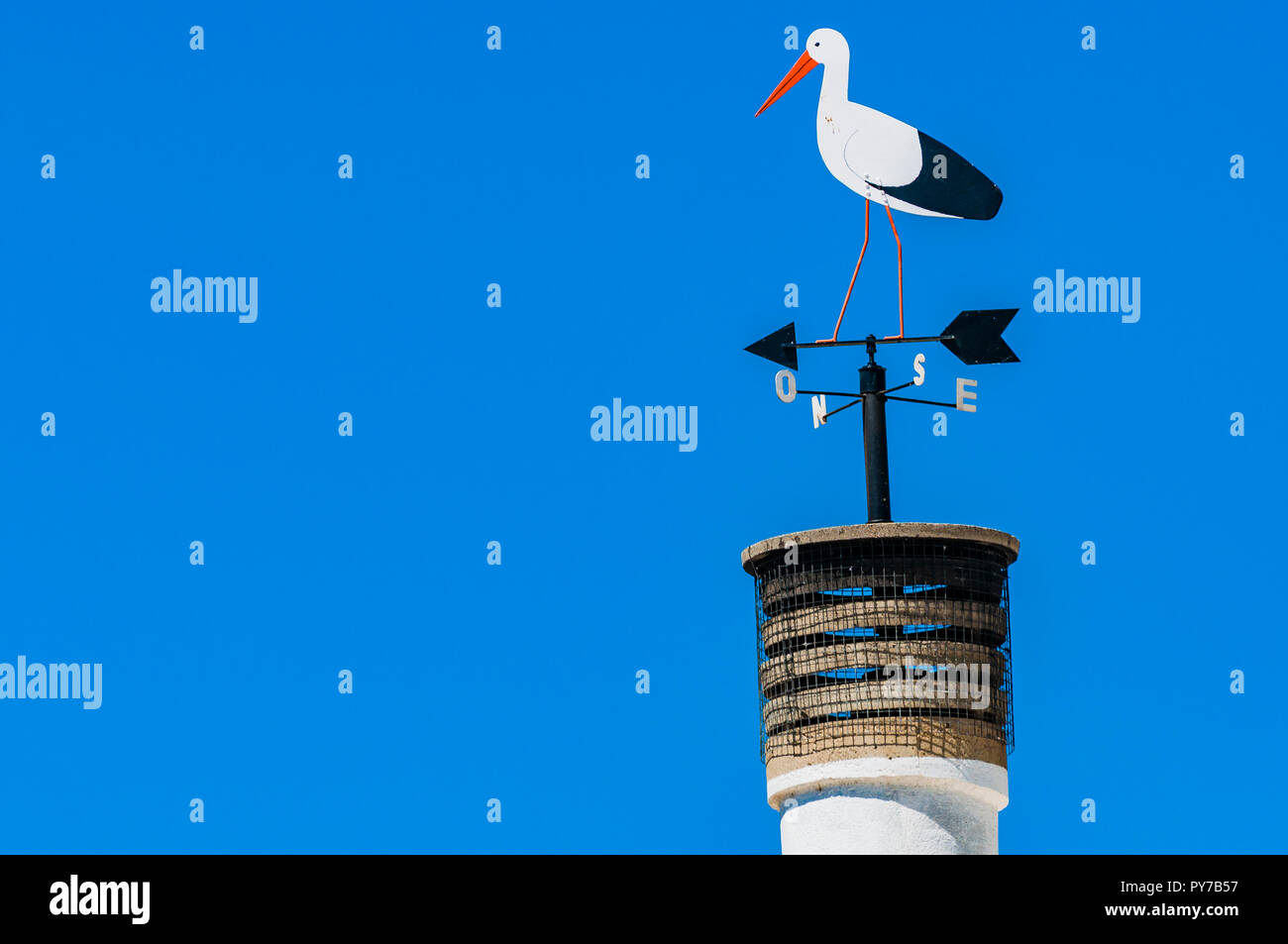 Village of El Gordo, the town with the largest stork colony in Spain. Weather vane representing a stork. El Gordo, Caceres, Extremadura, Spain, Europe - Stock Image