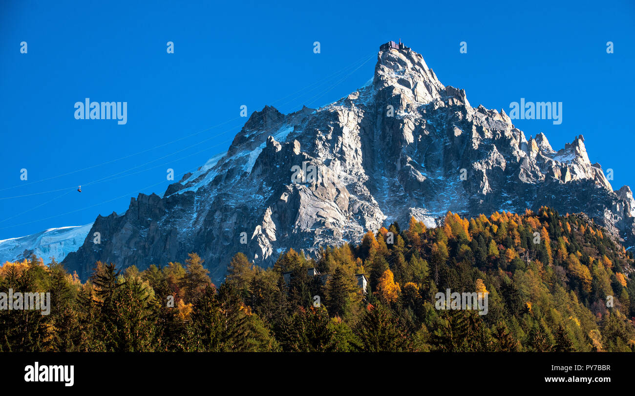 Aiguille du Midi, a mountain in the Mont Blanc massif within the French Alps. Popular tourist destination can be accessed by cable car from Chamonix. - Stock Image