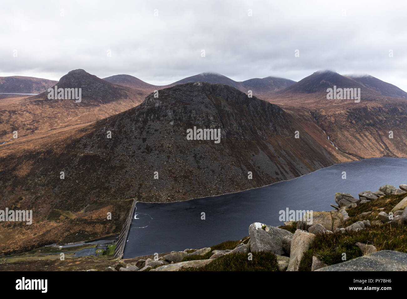 View of Ben Crom mountain and reservoir from lower slopes of Slieve Binnian. Doan mountain on left. Mourne Mountains, N.Ireland. - Stock Image