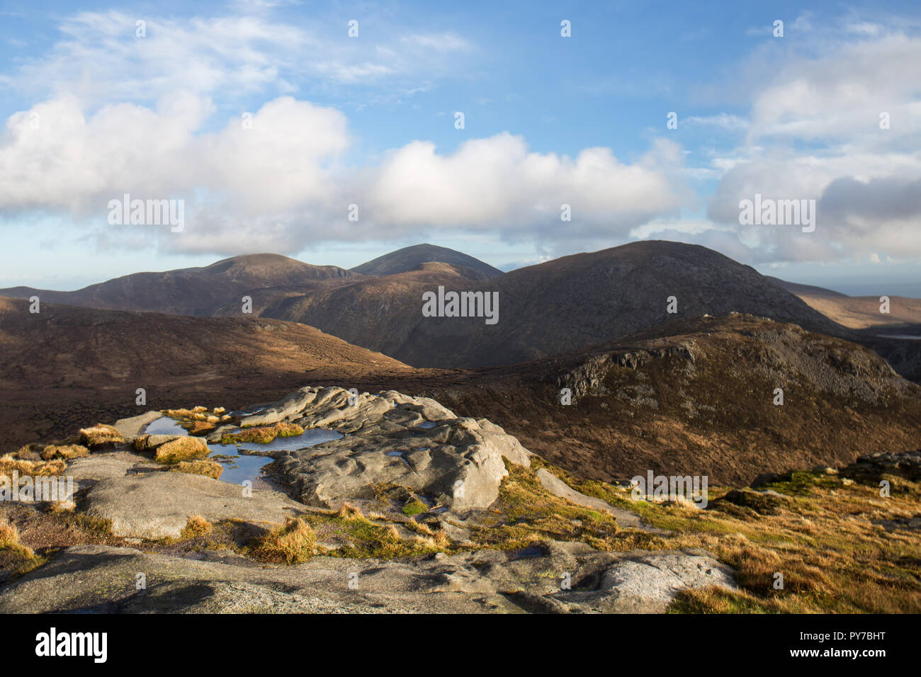 View from the summit of Doan Mountain. Ben Crom mountain on right, Slieve Lamagan behind and Slieve Donard in distance. Mourne Mountains, N.Ireland. - Stock Image