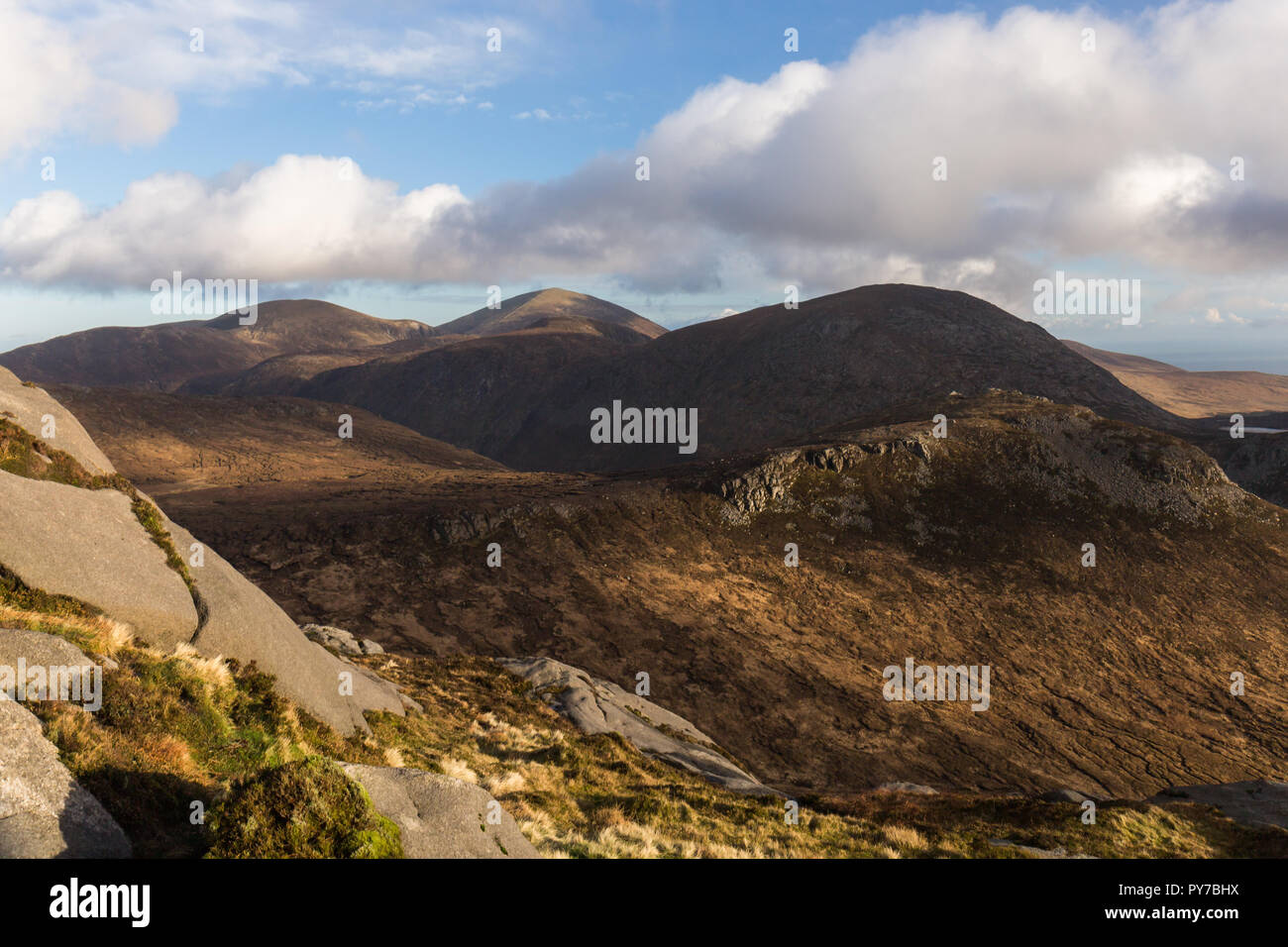View from the summit of Doan Mountain looking towars Slieve Donard in the distance. Ben Crom mountain on right, Slieve Lamagan behind. Mourne Mountain - Stock Image
