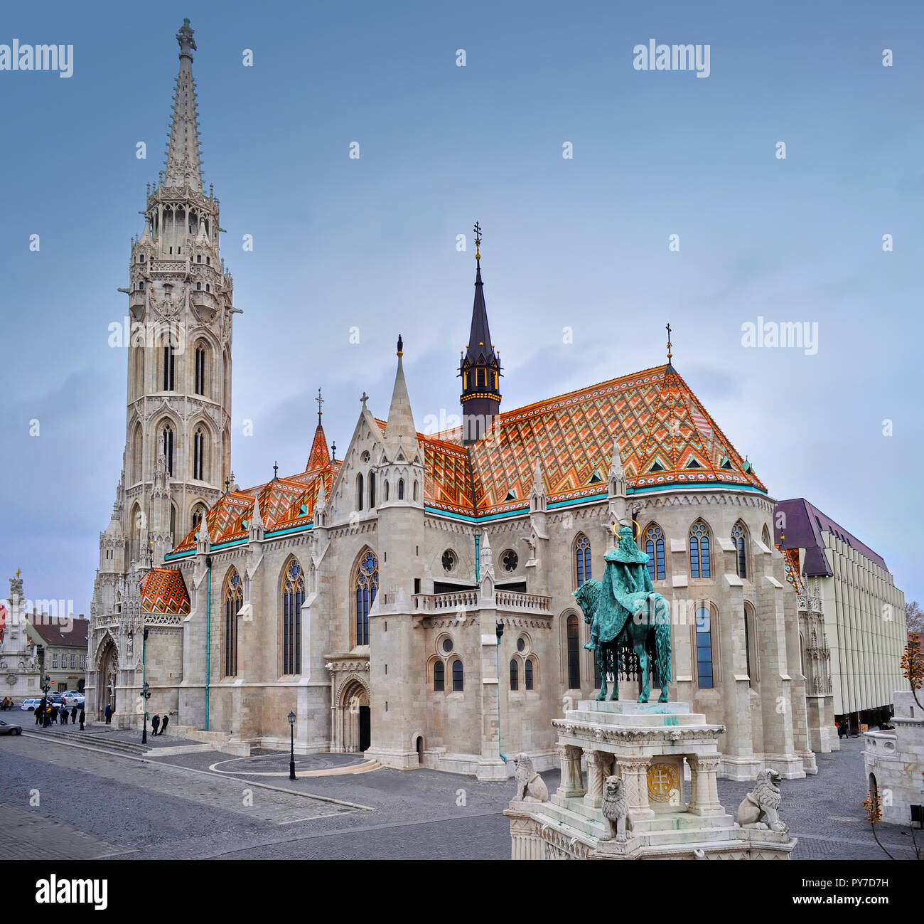 View on the Matthias Church and a sculpture of a man on a horse on a winter day. Shot from above. Budapest. Stock Photo