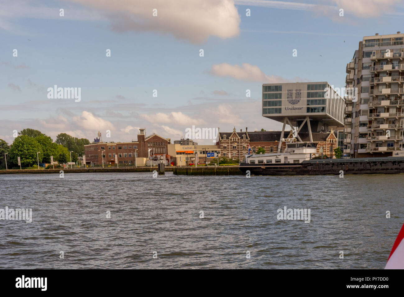 Rotterdam, Netherlands - 16 July, 2016: Netherlands dutch flag over the Unilever company.Unilever is a British-Dutch transnational consumer goods comp - Stock Image