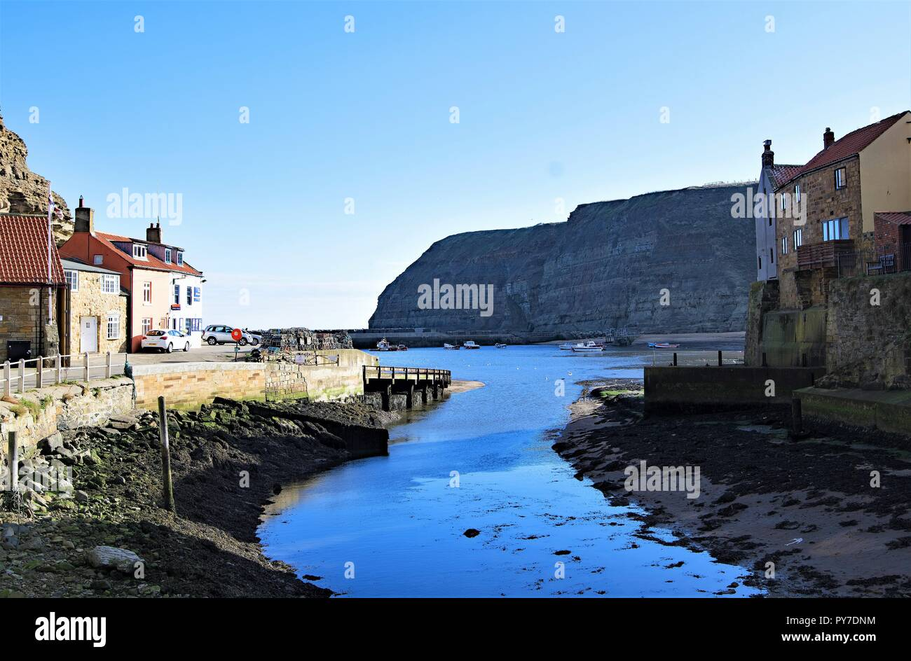 Taken to capture beautiful colourations, during a remarkably sunny day in late Autumn, within the North Yorkshire fishing village, of Staithes. - Stock Image