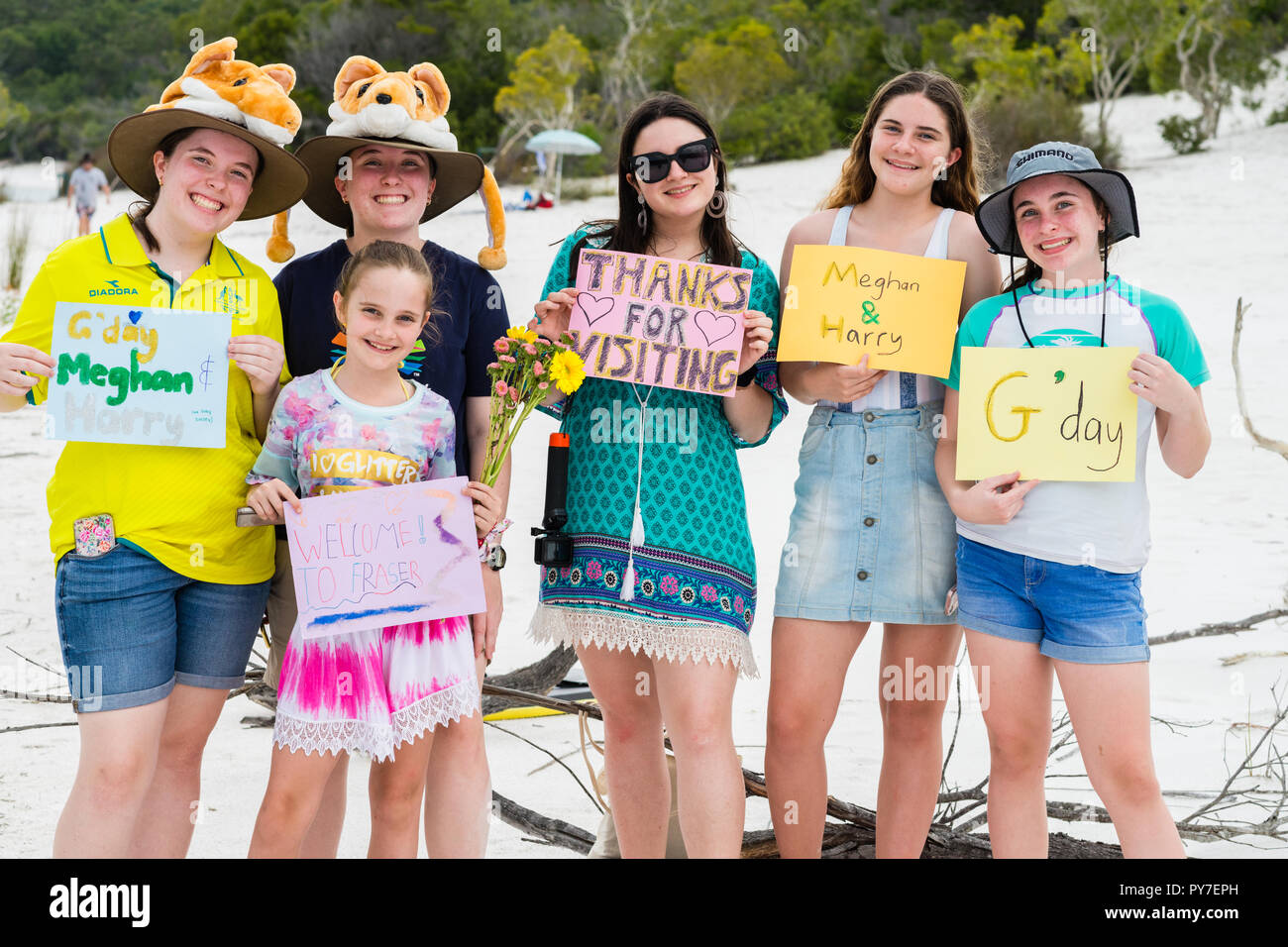Fraser Island, Australia - October 22, 2018: a group of teens with signs to welcome the Royals to Fraser Island Stock Photo