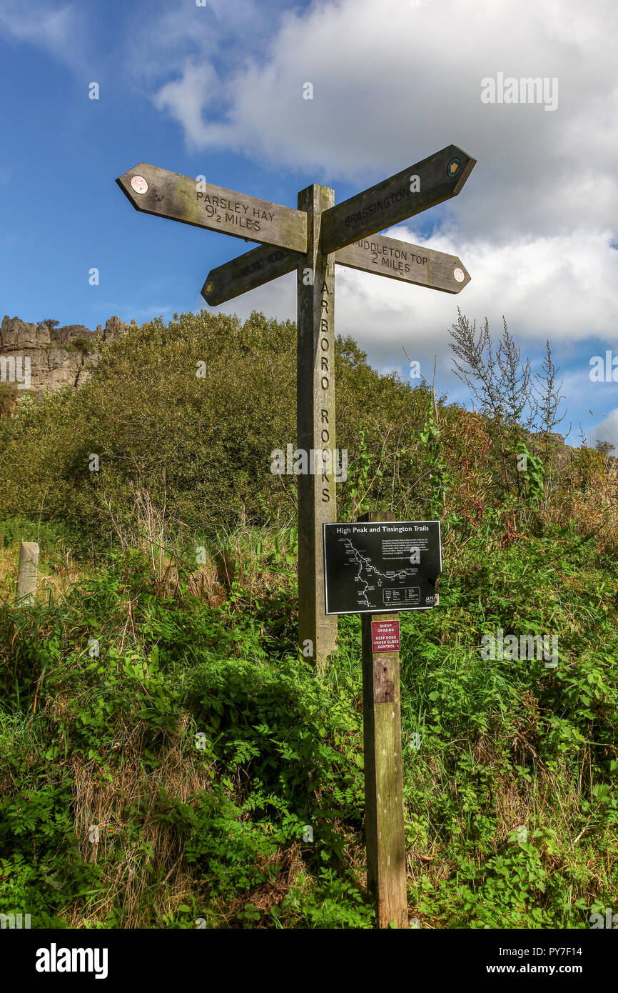 A wooden sign post at Harboro Rocks, High Peak Trail, on the high ridge above Brassington,  Derbyshire, England, UK, - Stock Image