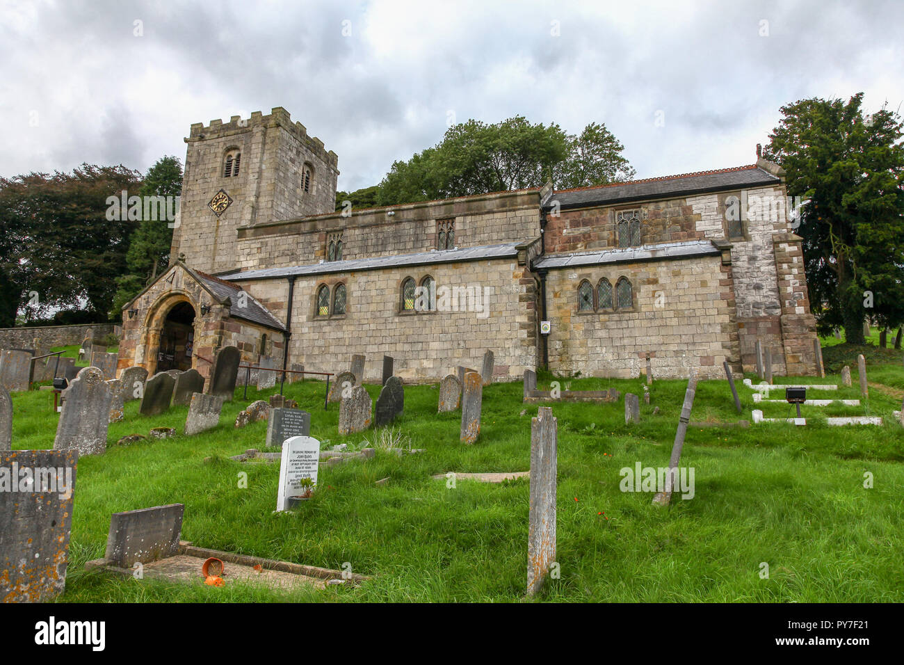 St James Church, or church of St James is a Norman Grade II* listed church at the heart of the village of Brassington, Derbyshire, England, UK - Stock Image