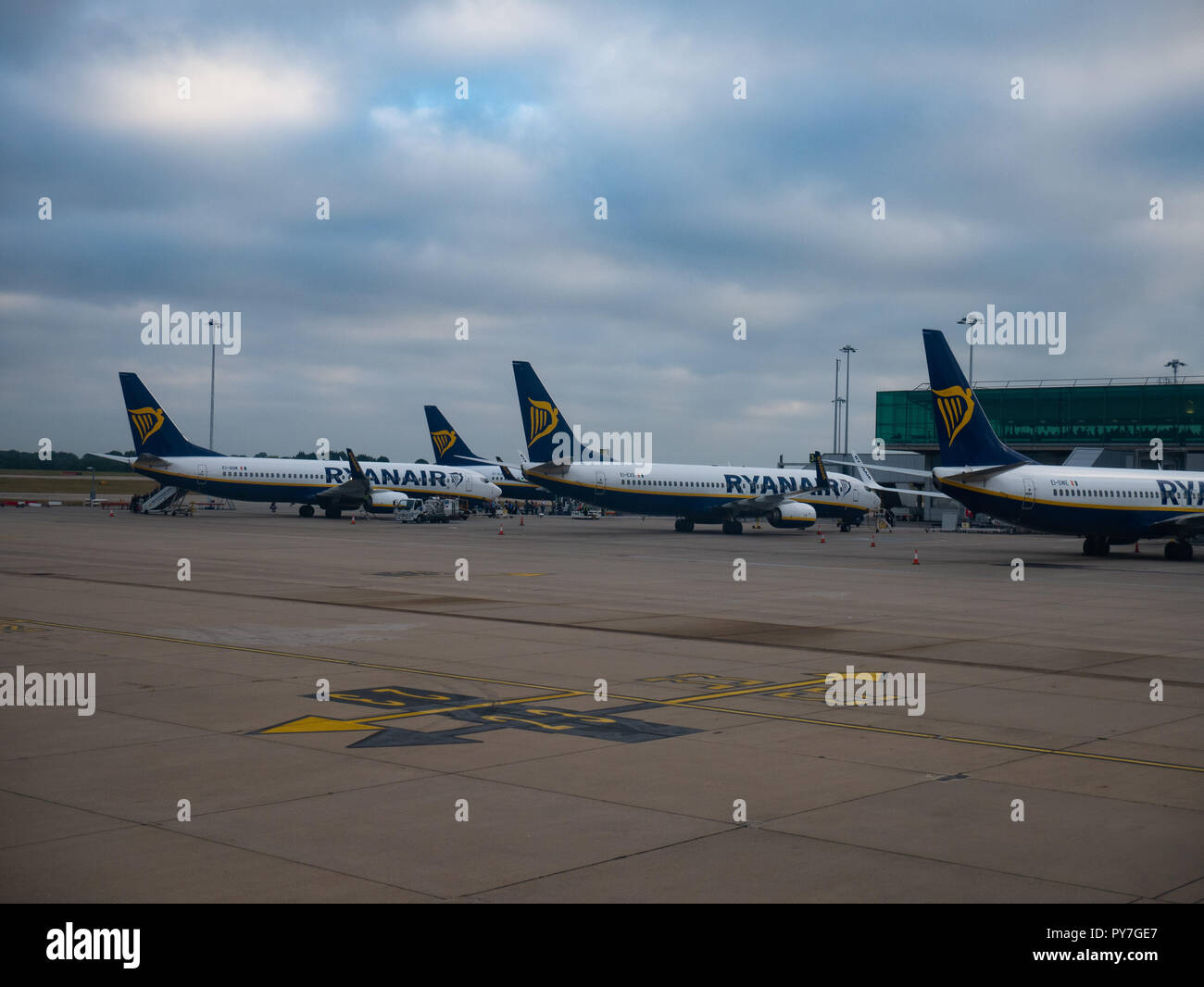 Ryanair planes parked at London Stansted Airport, Essex, England. - Stock Image