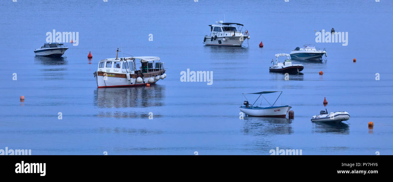 Anchored boats in twilight of a summer evening in Moscenicka Draga, Croatia - Stock Image