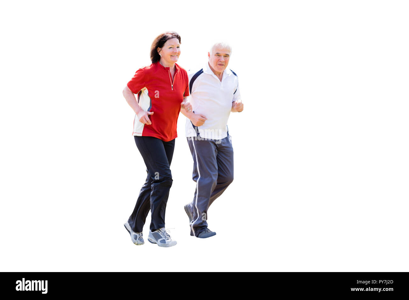 Portrait Of A Smiling Senior Couple Jogging On White Background - Stock Image
