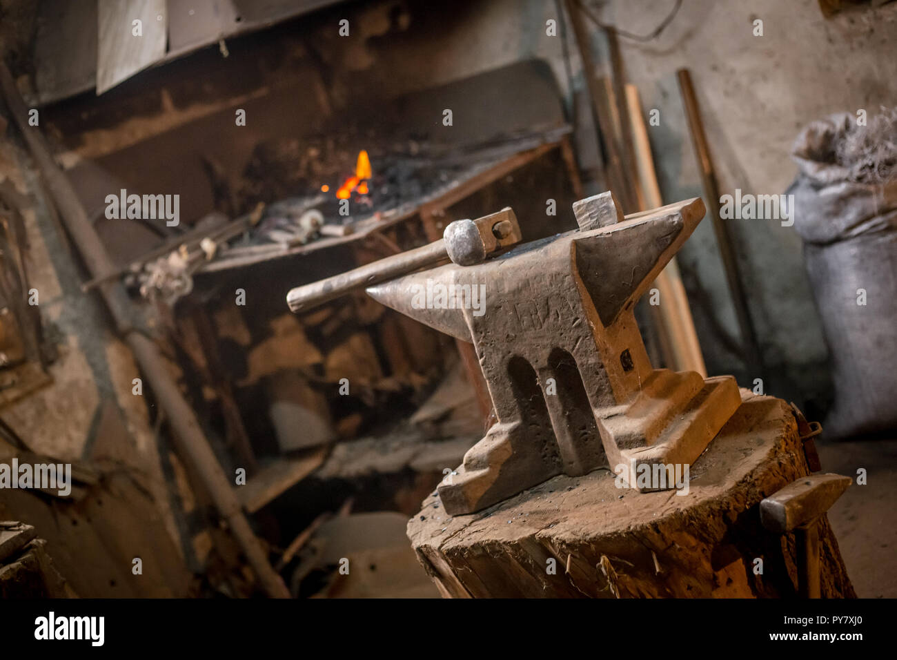 Old blacksmiths hammer on anvil in workshop read to be used for