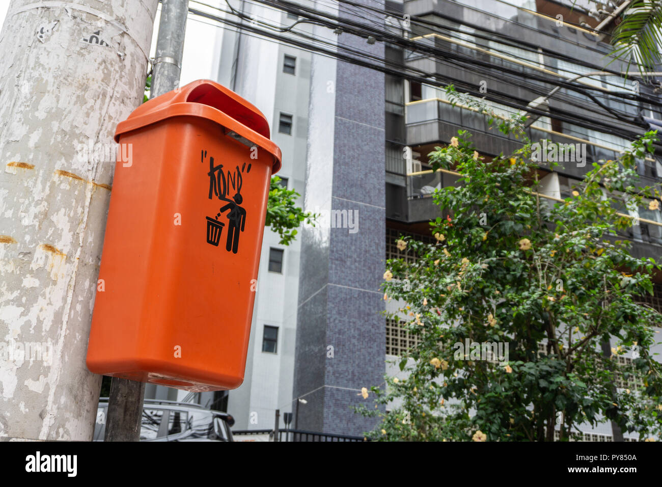 Orange Trash Can in the Streets - Stock Image