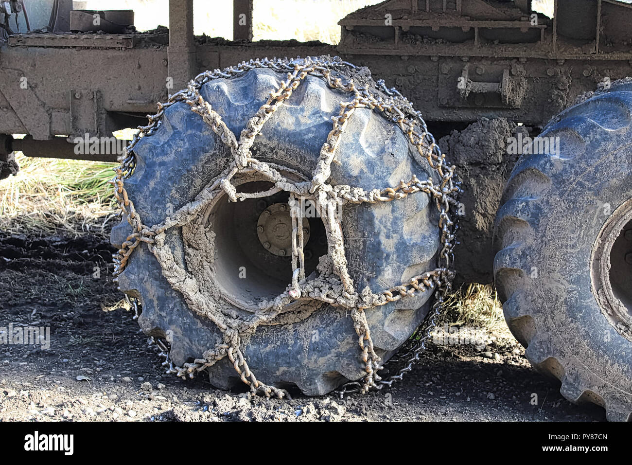 Chains used on a heavy equipment tire for grip - Stock Image