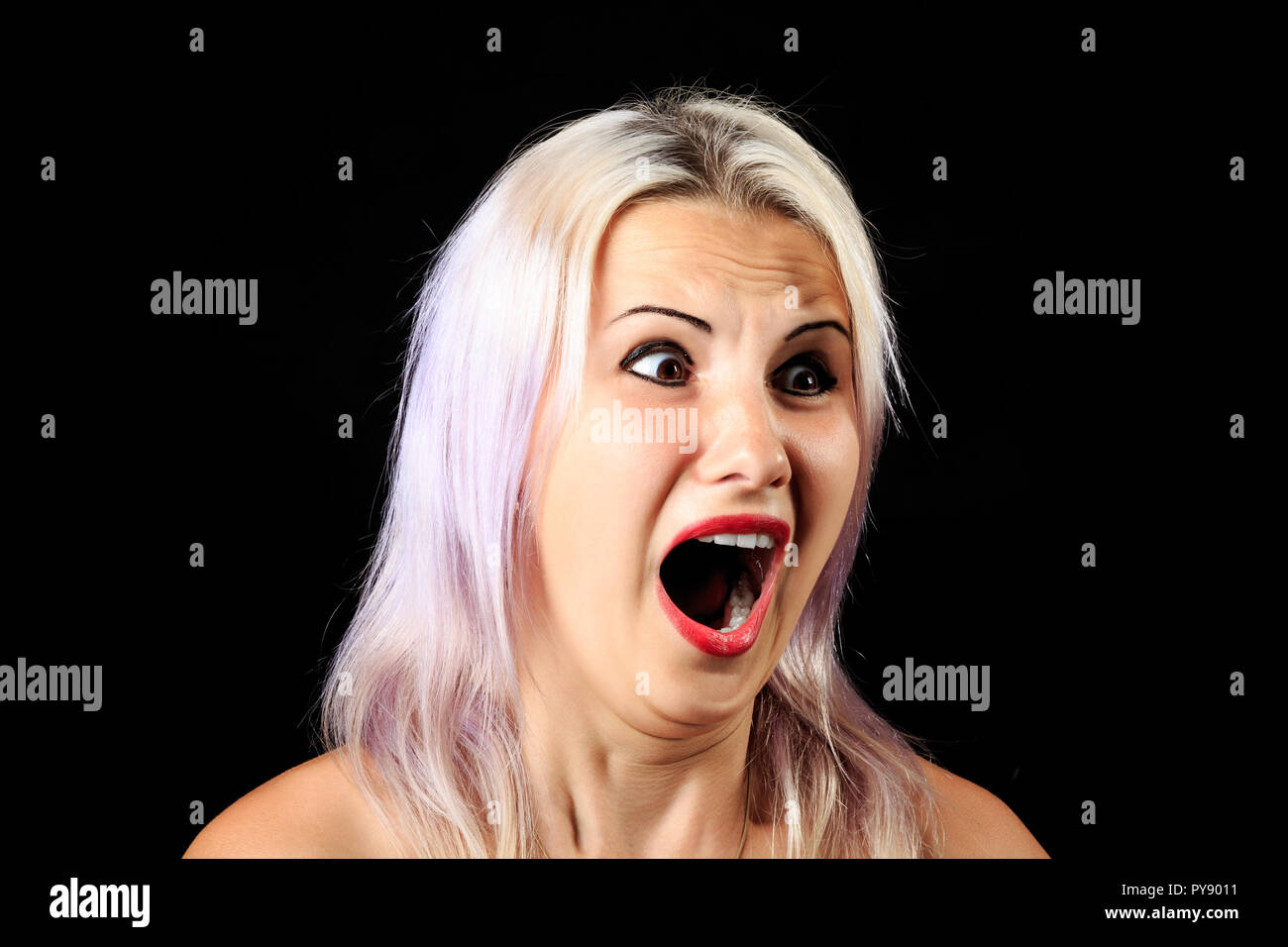 fearful female face expression, scared screaming shouting girl Stock Photo