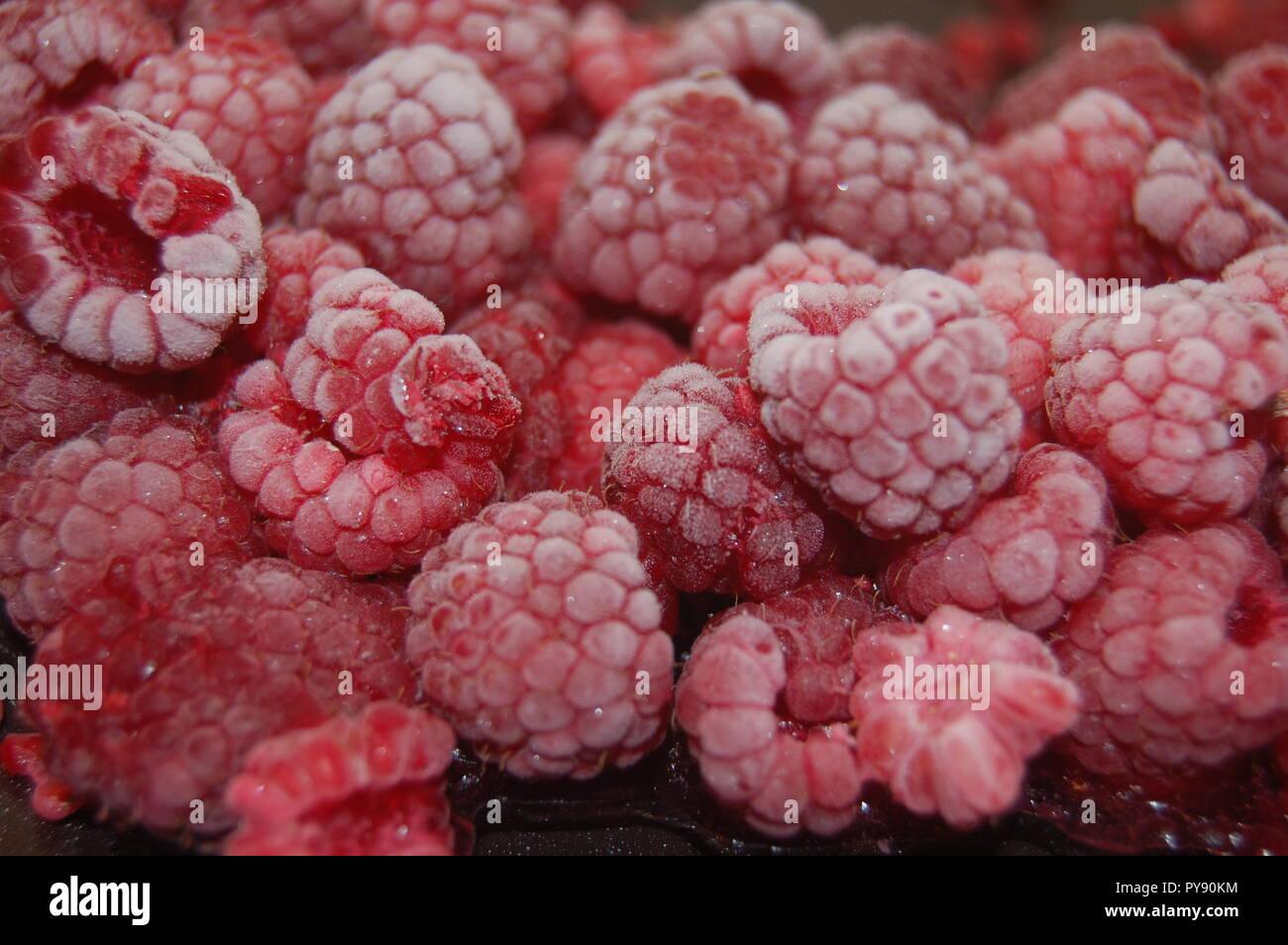Frozen fruit Raspberries - Stock Image