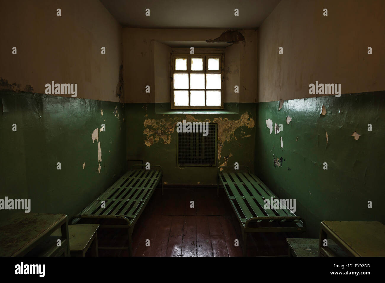 Museum of Genocide Victims Vilnius, view inside a prison cell used during the Nazi and Soviet occupations of Lithuania from 1930s to 1980s. - Stock Image