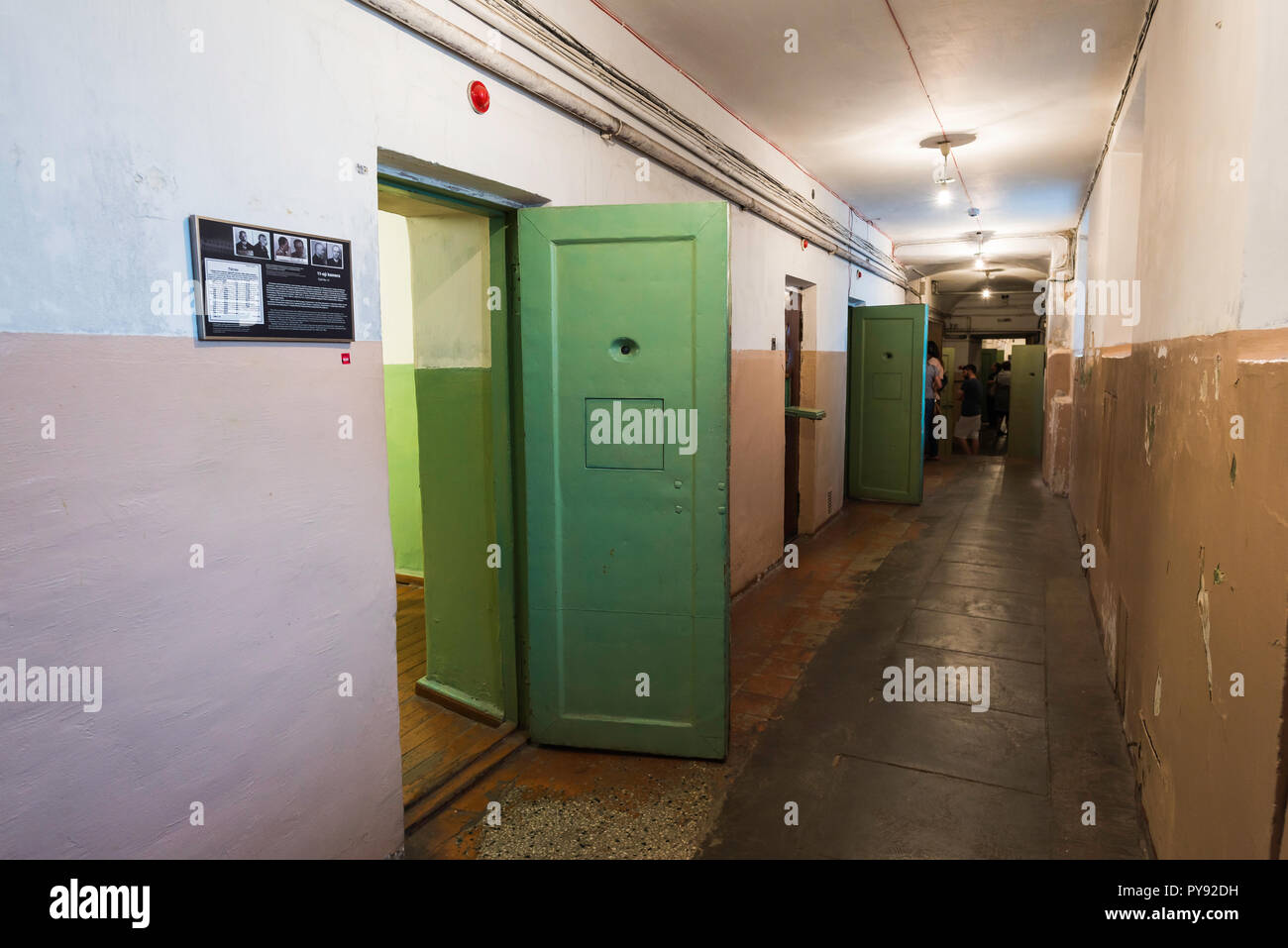 Vilnius Museum of Genocide Victims, view of a corridor in the museum basement showing former prison cells used during the Nazi and Soviet occupations. - Stock Image