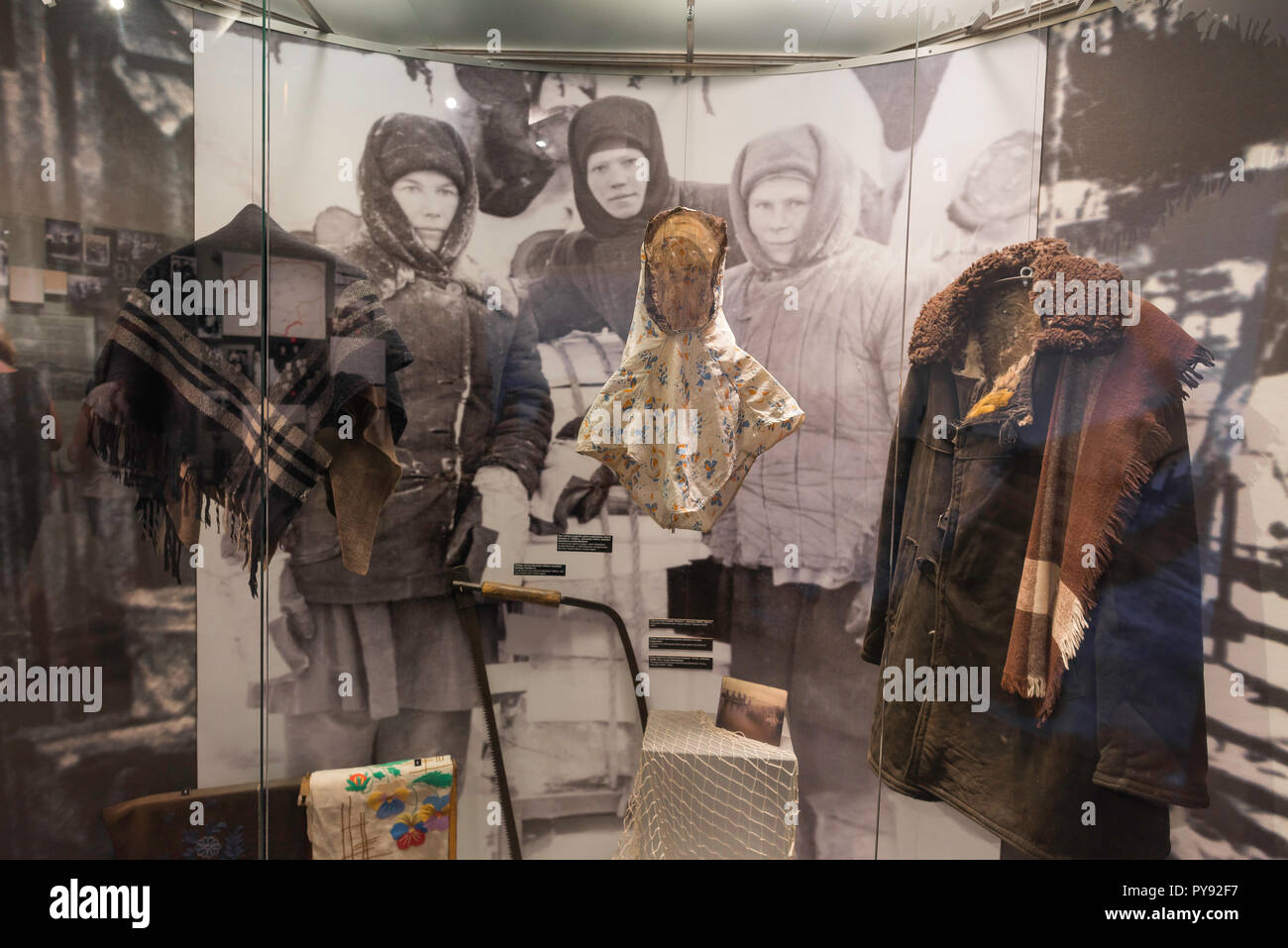 Vilnius Museum of Genocide Victims, view of a room in the museum displaying clothing of Lithuanian women exiled to Siberia by the Soviet authorities. - Stock Image