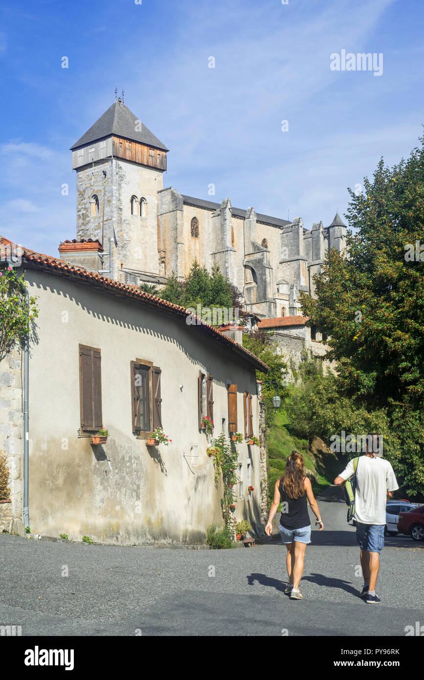 Tourists visiting the village Saint-Bertrand-de-Comminges, Haute-Garonne, Pyrenees, France - Stock Image