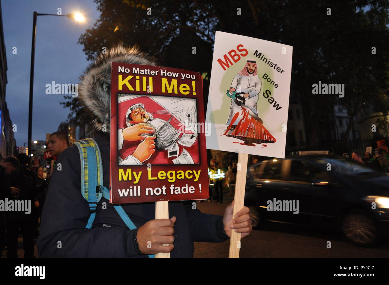 London/UK. 25 October 2018. 'Kill Me! My Legacy will not fade!' Posters and banners depicting the anger of the murder of Jamal Khashoggi, a dissident. - Stock Image