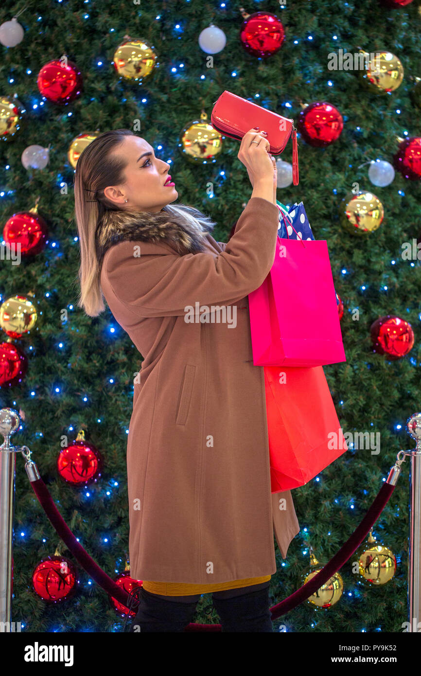 Big sale - Young girl no more money for Christmas shopping at a ...