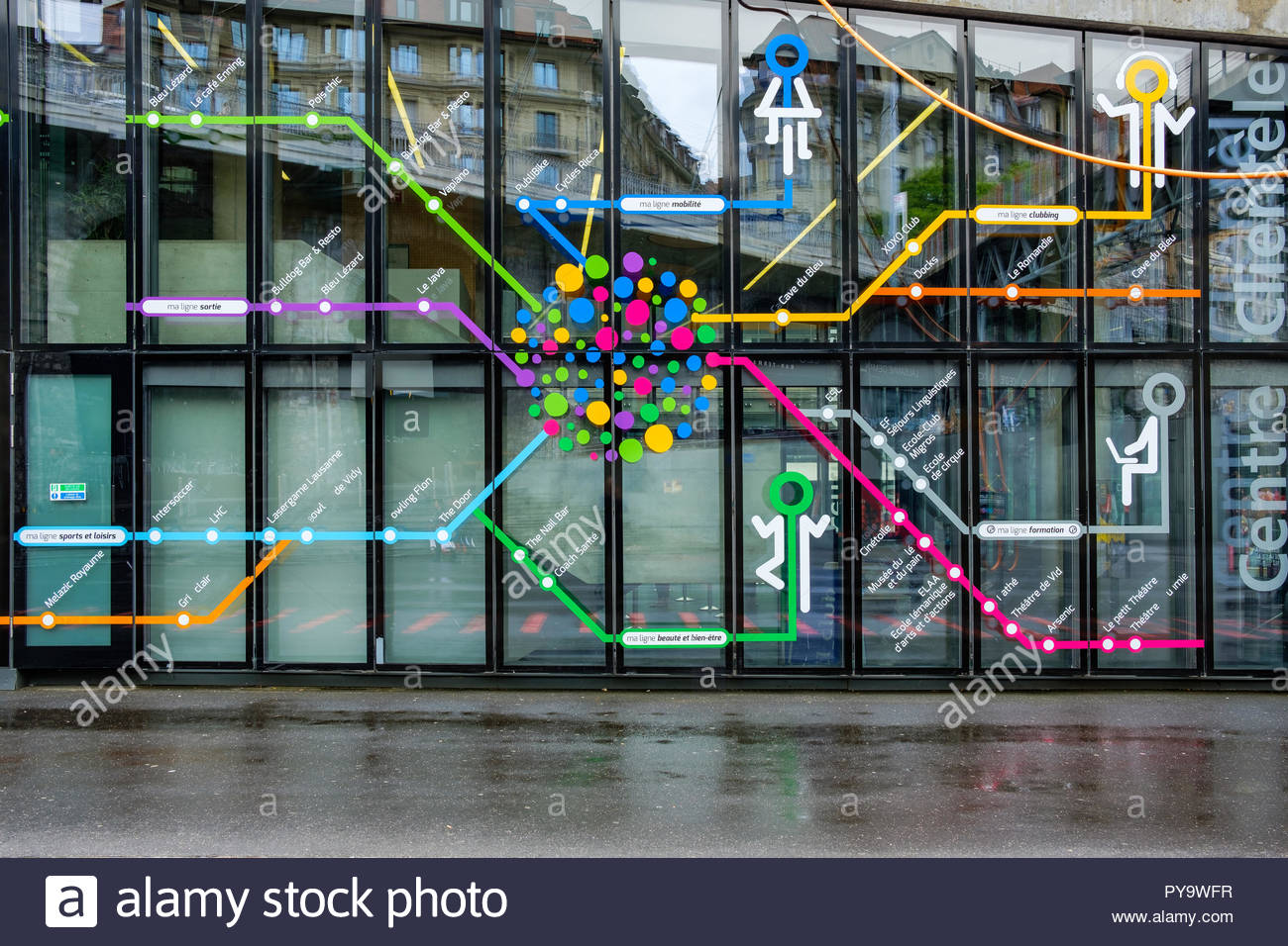 Map of metro lines on the window of the entrance of a metro station ...