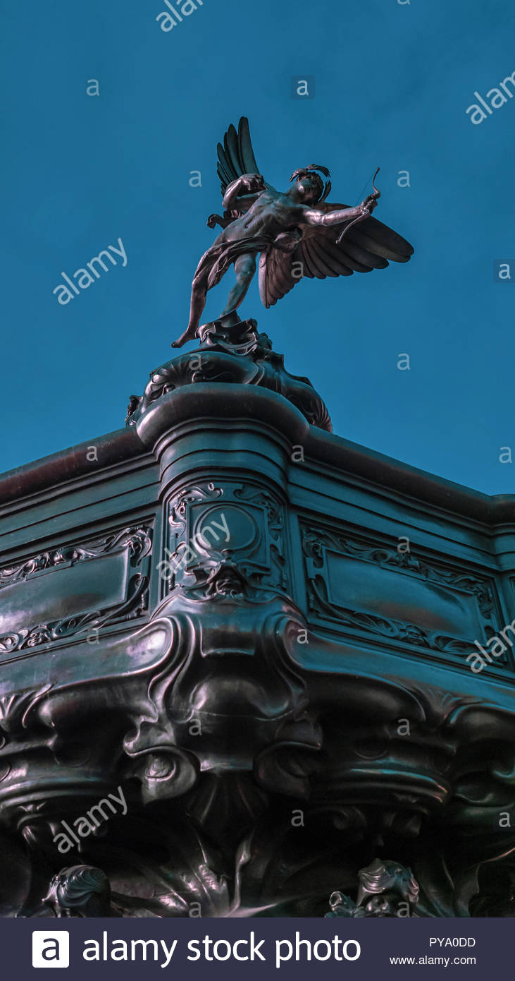 Eros statue on top of the Shaftesbury Memorial Fountain in Piccadilly Circus, London, UK. The statue was created by Sir Alfred Gilbert 1885-1893 - Stock Image