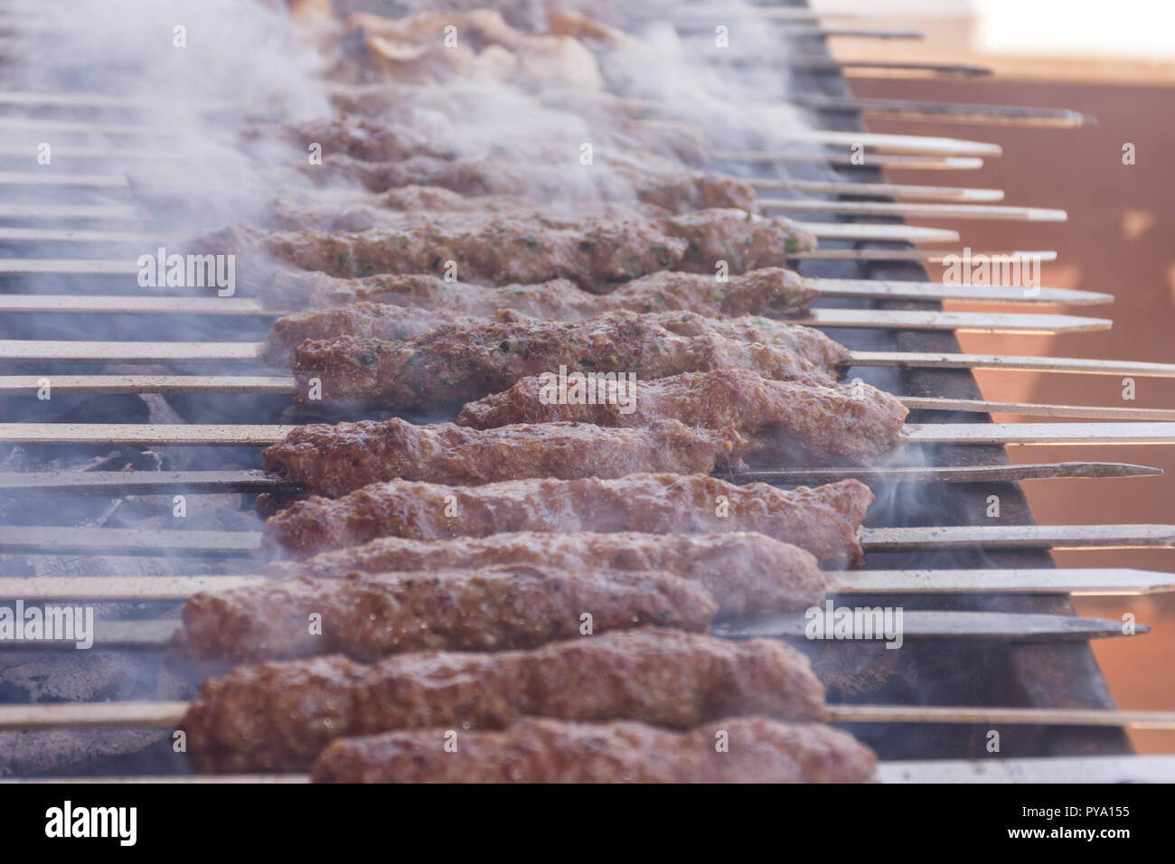 Closeup of kebab over hot charcoal barbecue Stock Photo