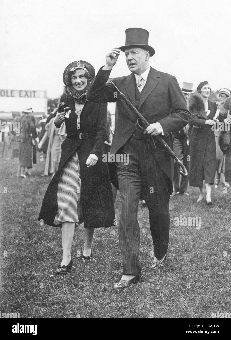 Coco Chanel , 1883-1971. French fashion designer and business woman. Founder and namesake of the Chanel brand with it's signature scent Chanel No. 5. Pictured here at the Epsom Derby horseracing event, together with the Duke of Westminster. May 31 1933 - Stock Image