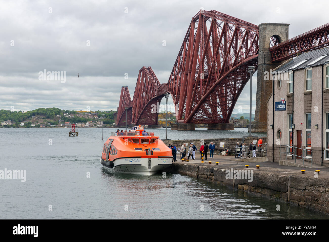 Forth Bridge in Scotland with tender cruise ship debarking passengers Stock Photo