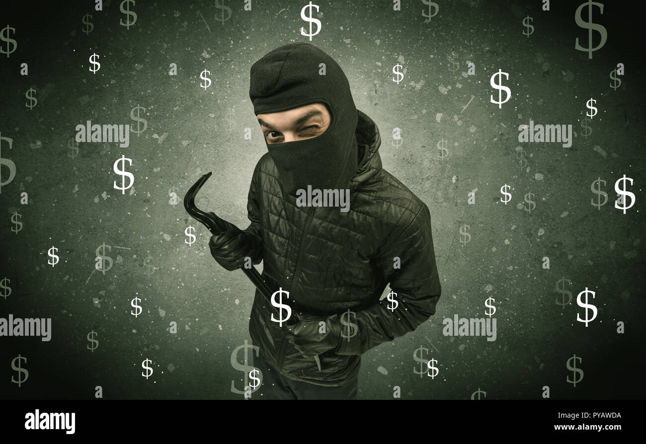 Money hungry thief in black clothes and tolls on his hand. - Stock Image